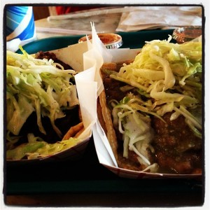 Each taco has beans, rice and cabbage...
