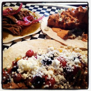 Clockwise from 11:00: carnitas (not sampled by me), the fish and the chicken.